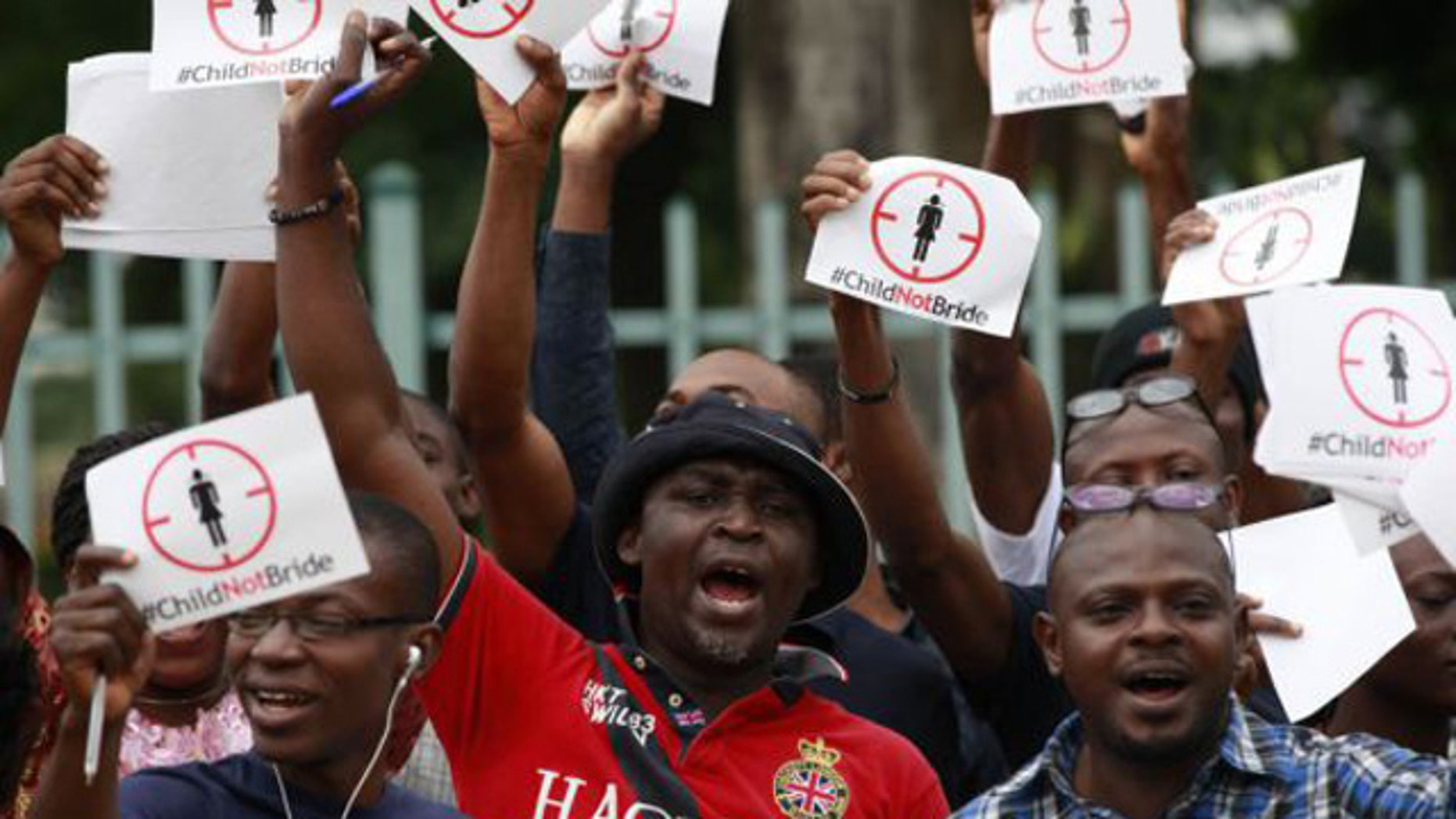 July 20, 2013: People protest against underage marriages in Lagos, Nigeria. (AP/Sunday Alamba, File)