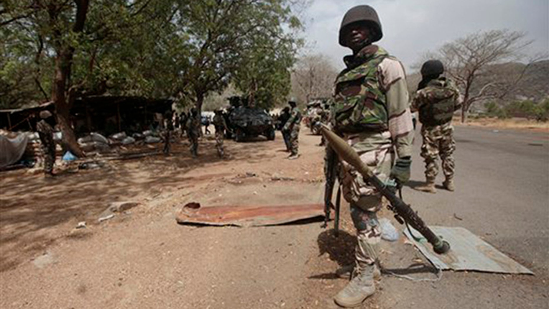 In this 2015 file photo, Nigerian Soldiers man a check point in Gwoza, Nigeria, a town newly liberated from Boko Haram. Nigeria's military says it is moving 200 girls and 93 women from a northeastern forest where they were rescued from Boko Haram extremists.