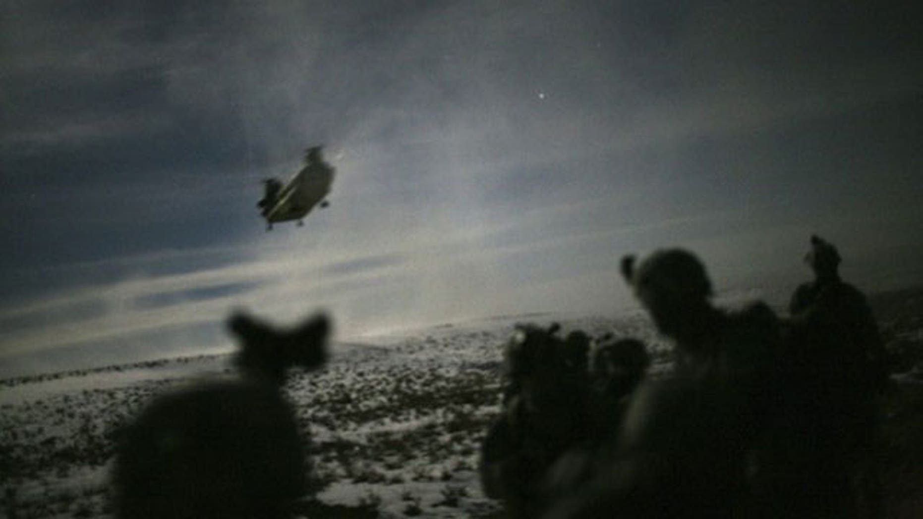 February 21, 2011: A Chinook helicopter lands to pick up U.S. soldiers of the 101st Airborne Division following a night raid in Yahya Khel, Paktika province.