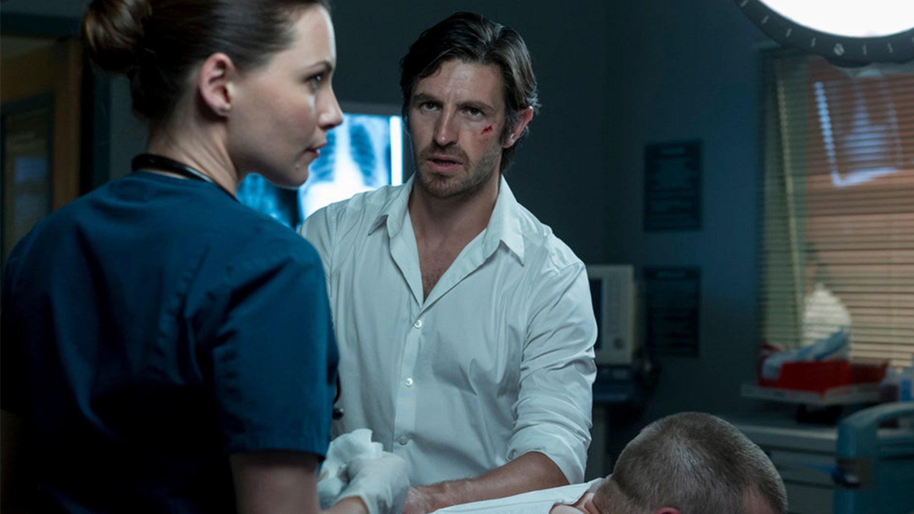 "Pictured: (l-r) Jill Flint as Jordan Alexander, Josh Kelly as Xavier Arnold, Eoin Macken as TC Callahan in NBC's ""Night Shift."""