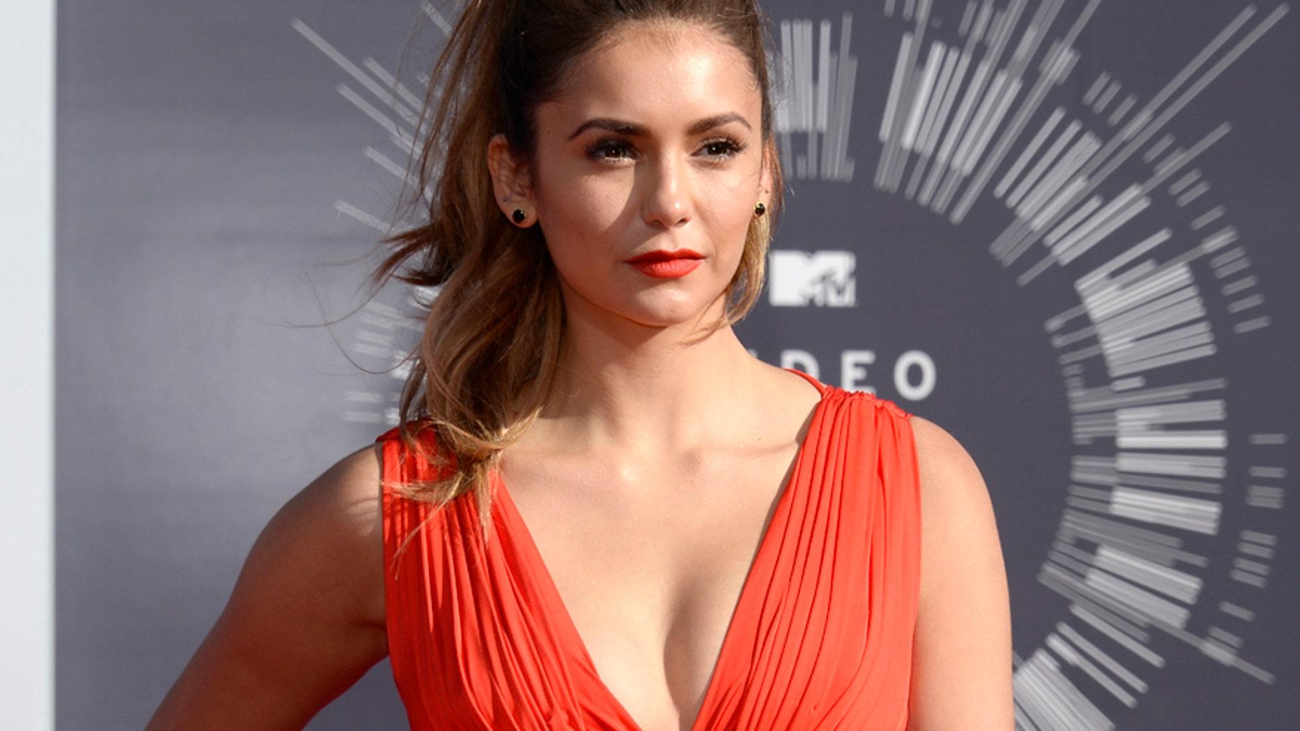 Nina Dobrev arrives at the 2014 MTV Music Video Awards in Inglewood, California August 24, 2014.