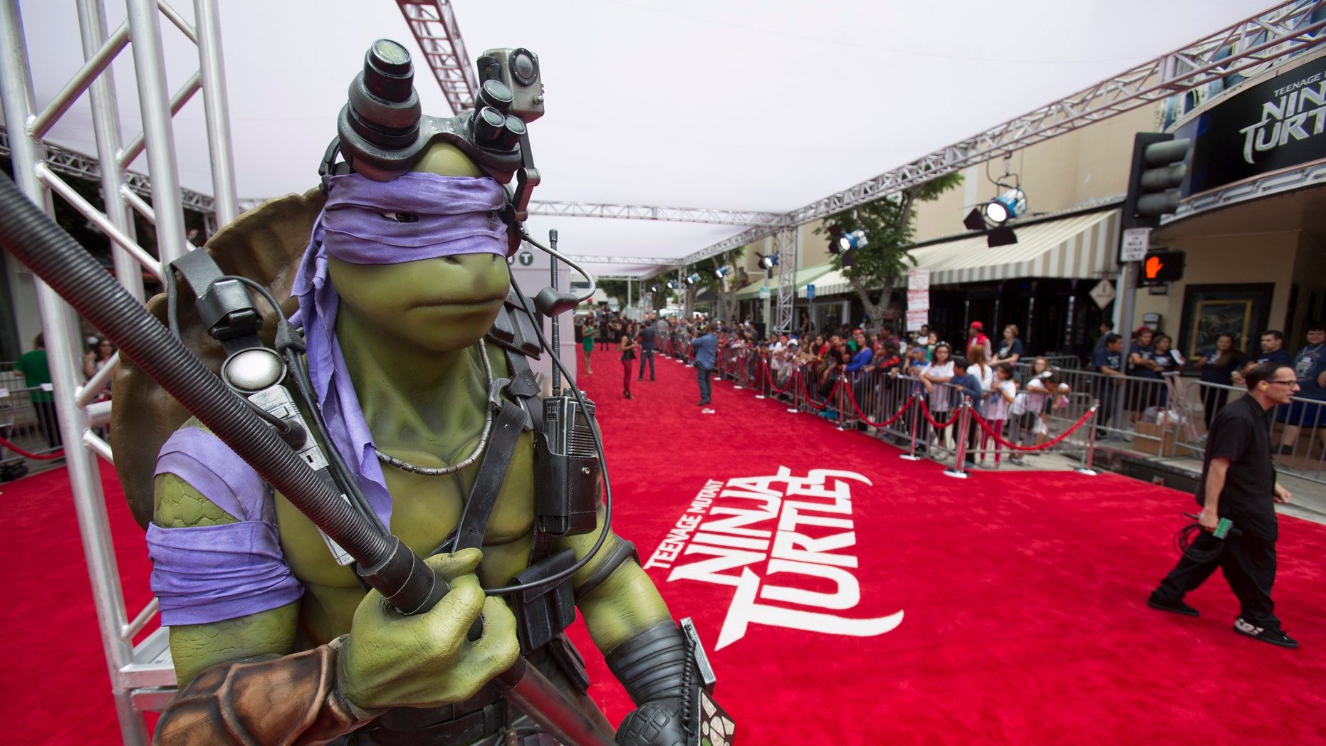 """File photo: A life-size model of the character """"Donatello"""" is pictured at the premiere of """"Teenage Mutant Ninja Turtles"""" in Los Angeles, California August 3, 2014.  (REUTERS/Mario Anzuoni)"""