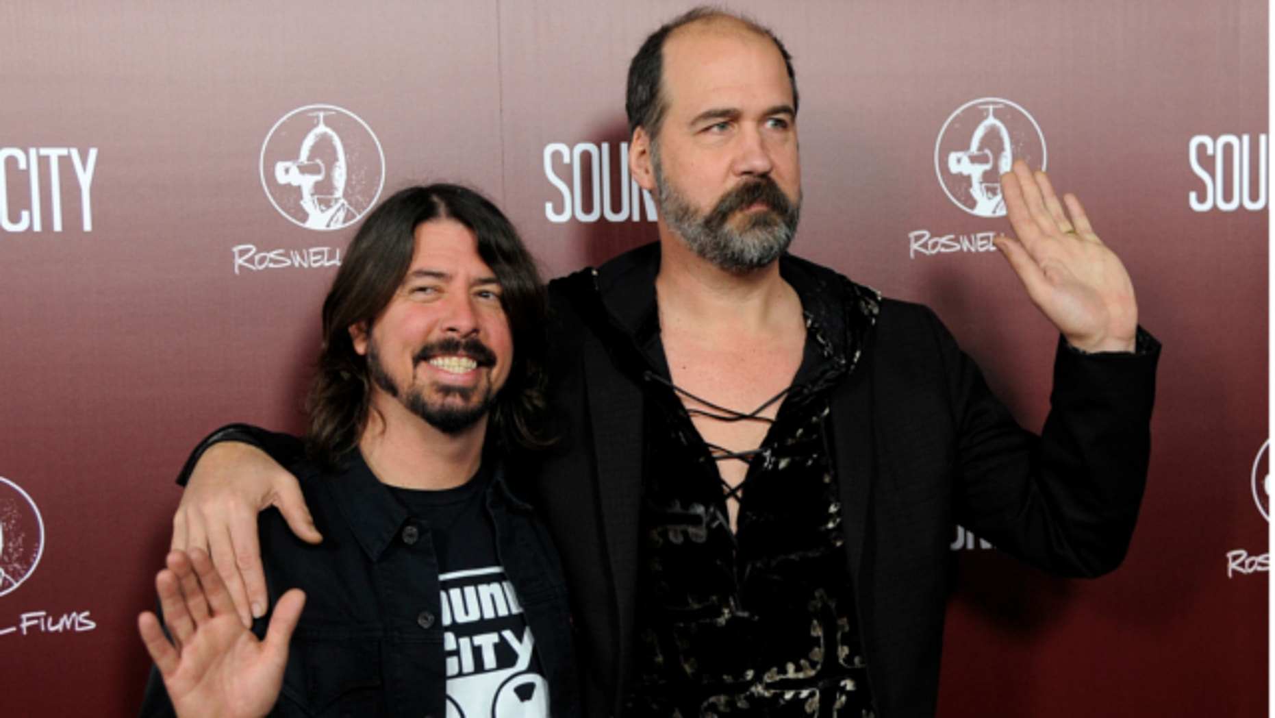 """Jan. 31, 2013: Dave Grohl, left, poses with Nirvana bandmate Krist Novoselic at the premiere of the documentary film """"Sound City,"""" in Los Angeles."""