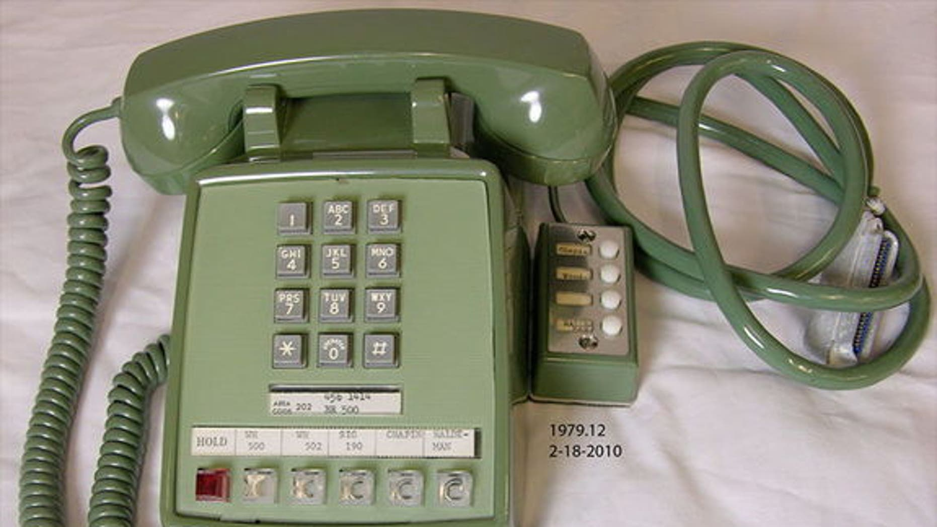 On July 20, 1969, President Richard M. Nixon used this olive green telephone to talk to the first astronauts on the moon. The same phone is now on display at the National Archives in Washington, D.C.