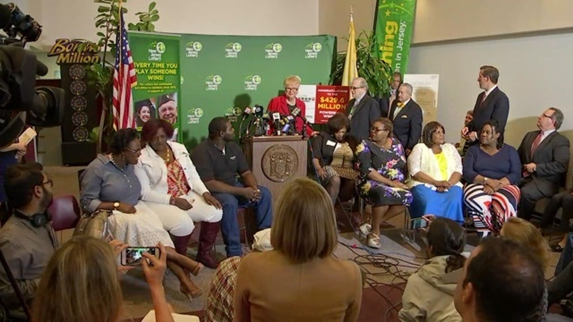 The Smith family with lottery officials at a news conference.