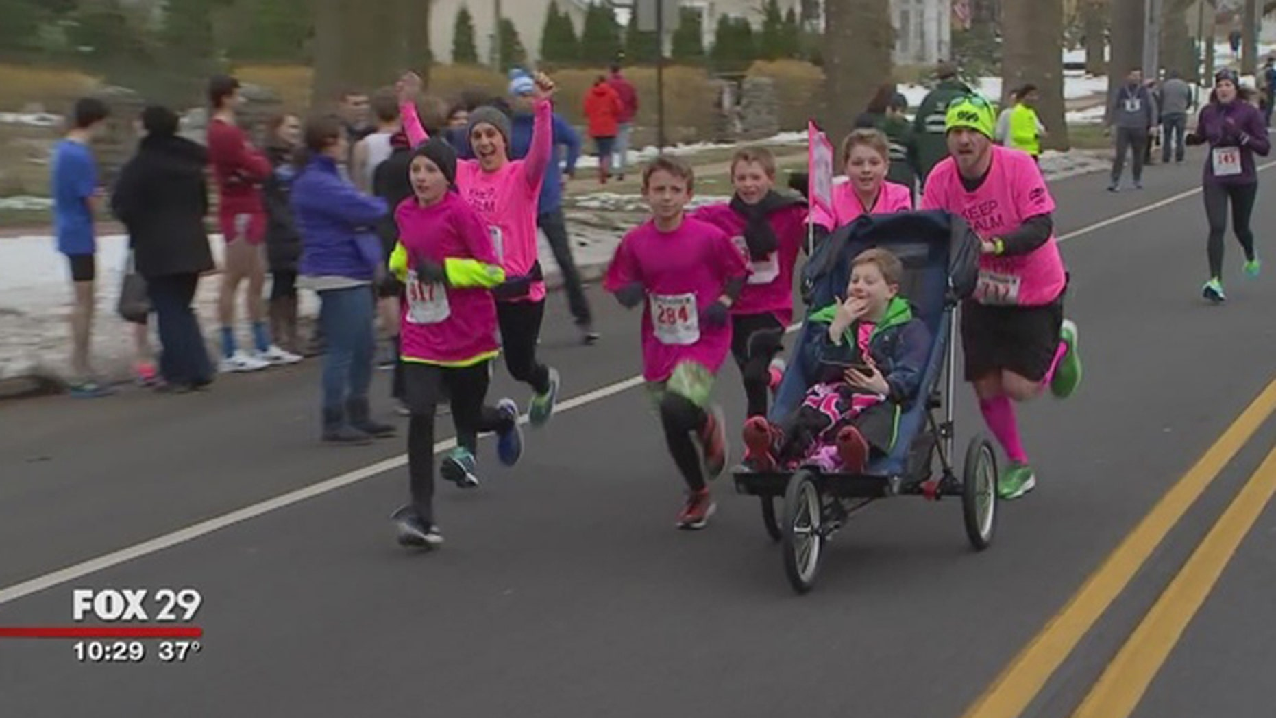 10-year-old Andrew Sylvester pushed by Vincent Myers during the Haddonfield Adrenaline 5K.