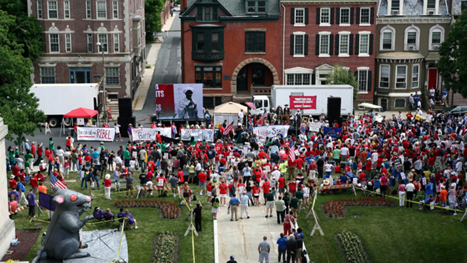 June 20: A large gathering of public employee union members and supporters protest in Trenton, N.J., outside the Statehouse over plans by Gov. Chris Christie to reduce benefits and limit collective bargaining over health care for public workers.