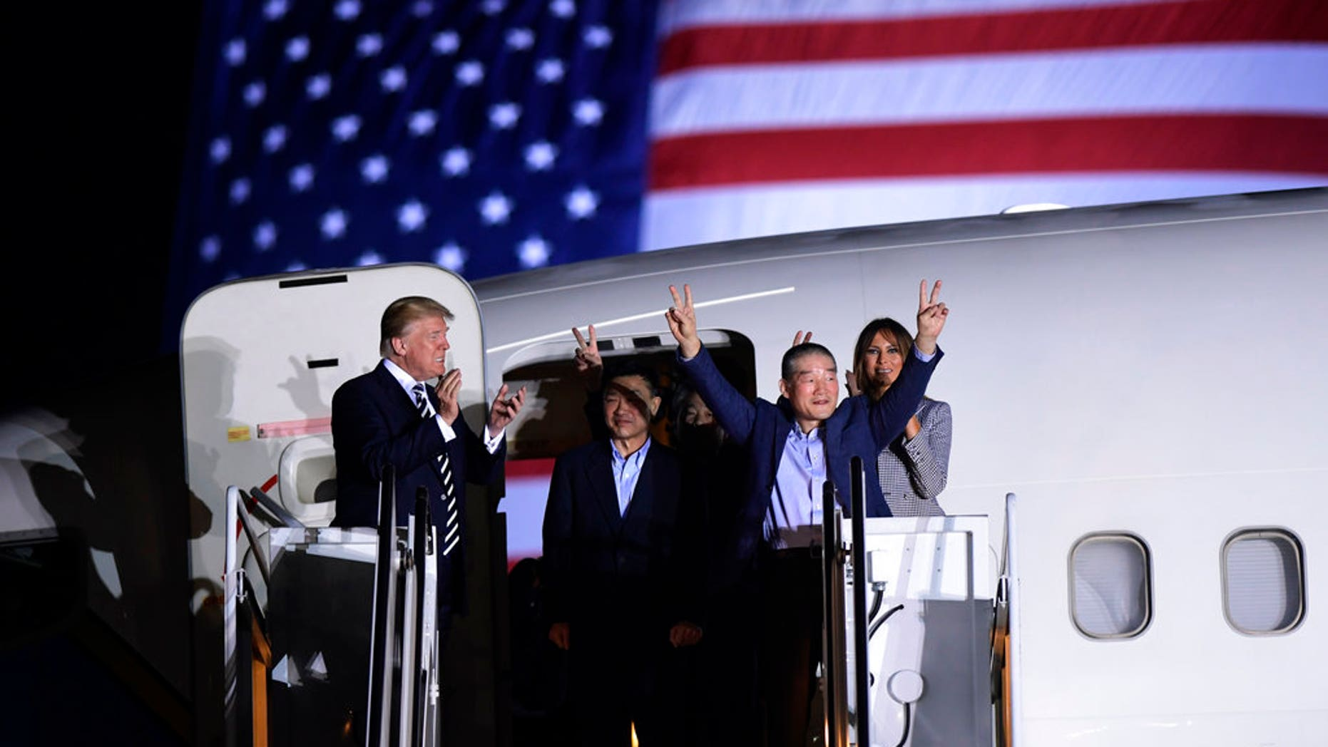 President Donald Trump, from left, greets Tony Kim, Kim Hak Song, seen in the shadow, and Kim Dong Chul, three Americans detained in North Korea for more than a year, as they arrive at Andrews Air Force Base in Md., Thursday, May 10, 2018. First lady Melania Trump also greets them at right. (AP Photo/Susan Walsh)
