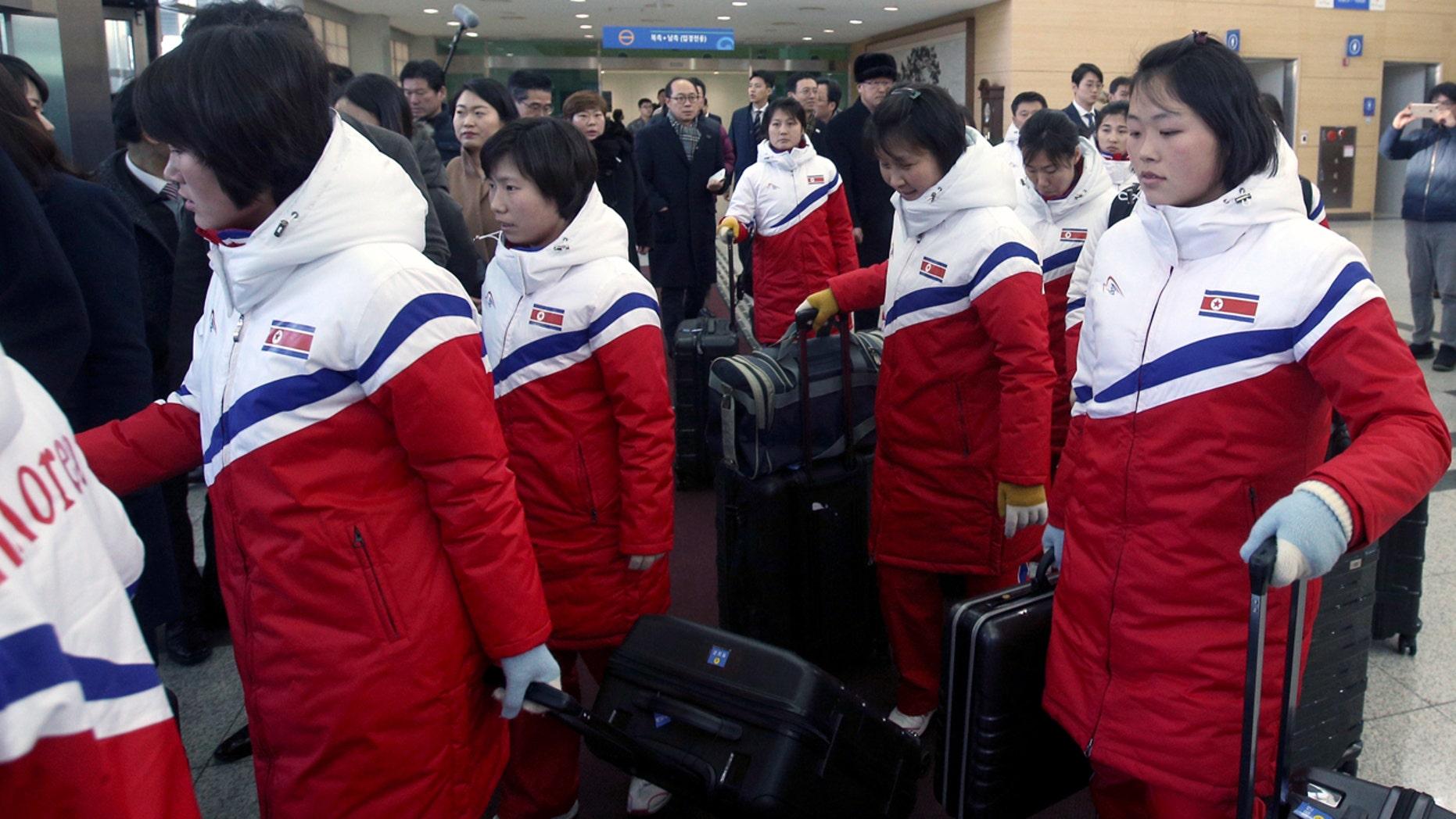 North Korean women's hockey players arrive at the Inter-Korean Transit Office in Paju, South Korea, Thursday.