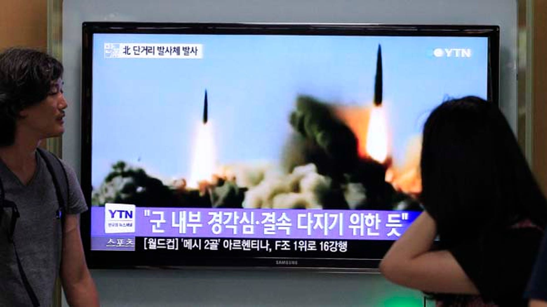 June 26, 2014: People watch a TV news program showing the missile launch conducted by North Korea, at Seoul Railway Station in Seoul, South Korea. (AP)
