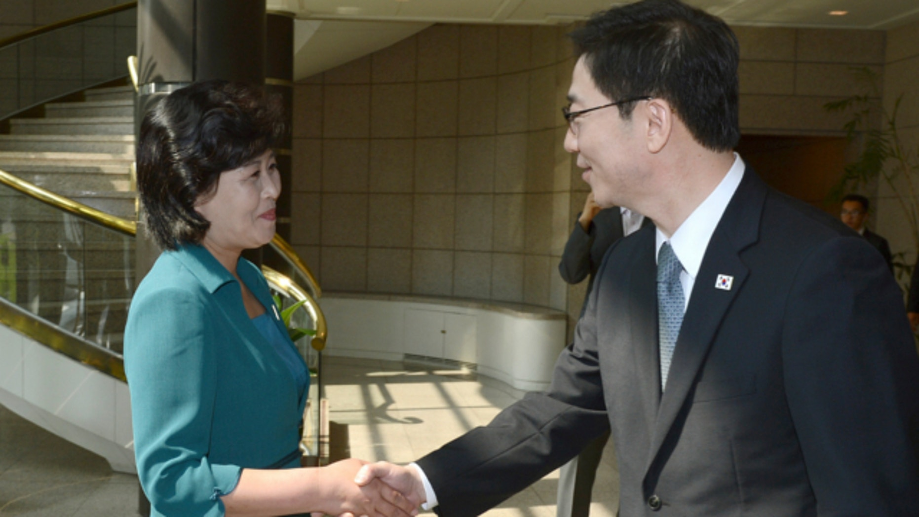 June 9, 2013: In this photo released by the South Korean Unification Ministry, South Korea's Unification Policy Officer Chun Hae-sung, right, shakes hands with the head of North Korea's delegation Kim Song Hye, left, upon Kim's arrival to their meeting at the southern side of Panmunjom, which has separated the two Koreas since the Korean War, in Paju, north of Seoul, South Korea.