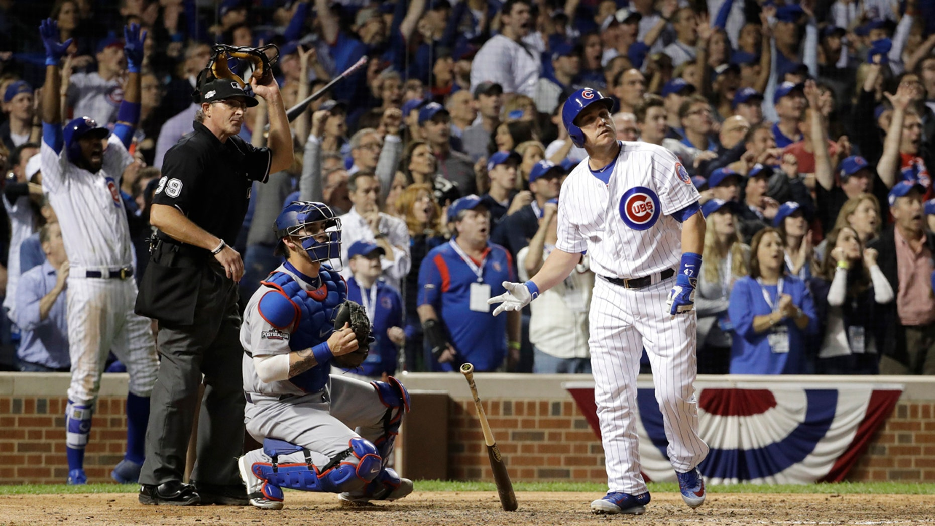 Oct. 15, 2016: Chicago Cubs catcher Miguel Montero (47) watches the ball as he hits a grand slam during the eighth inning of Game 1 of the National League baseball championship series against the Los Angeles Dodgers in Chicago