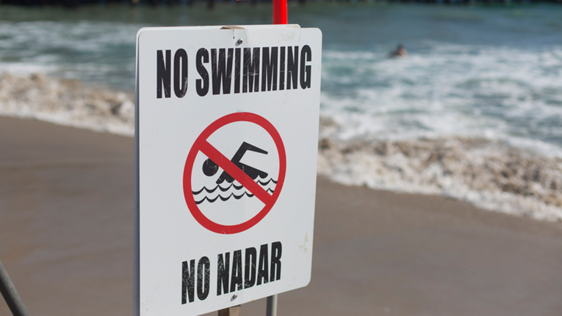 You may want to heed the sign and refrain from swimming in these dangerous places.
