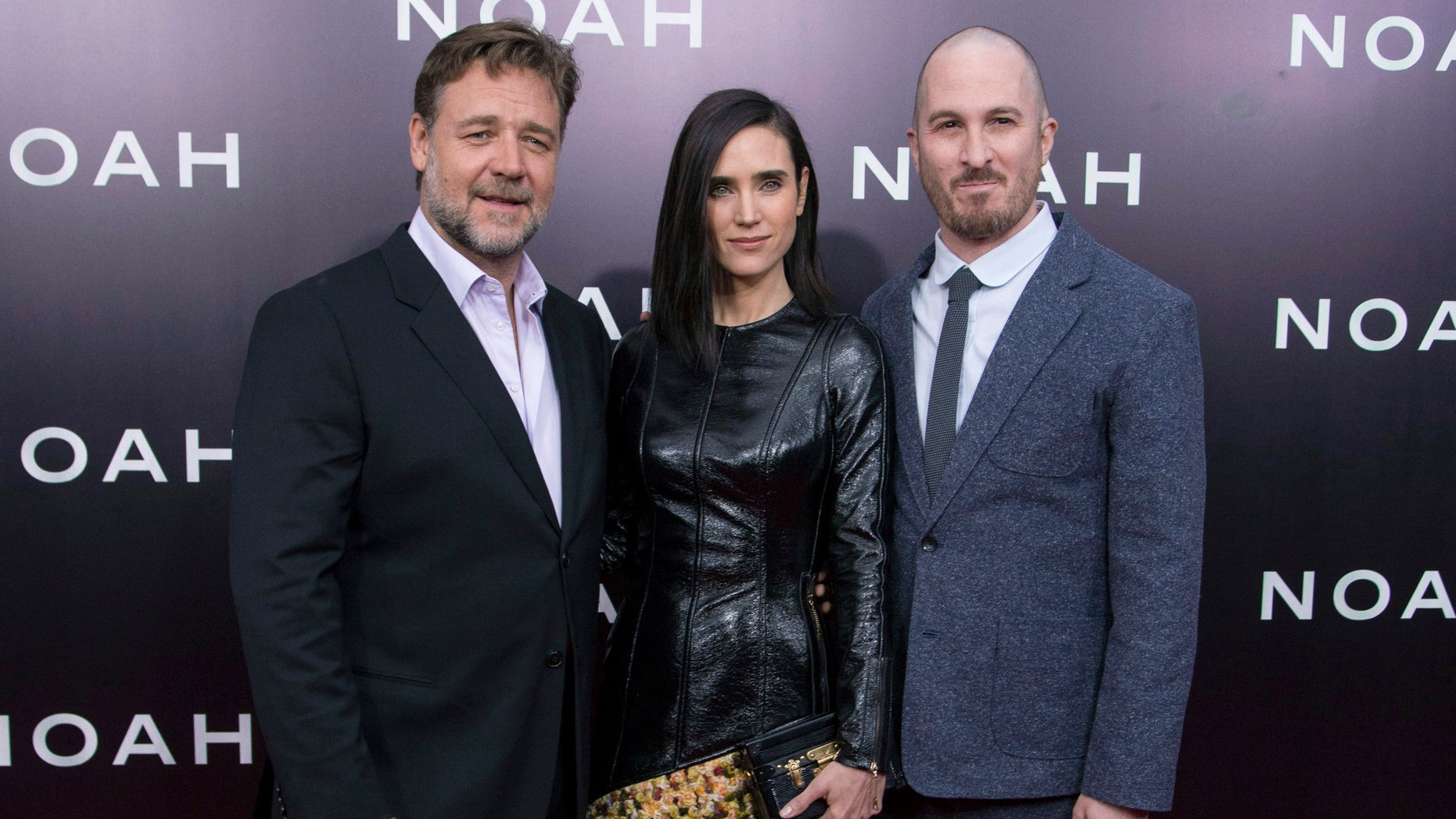 """March 26, 2014. (L-R) Cast members Russell Crowe and Jennifer Connelly pose with director Darren Aronofsky during the U.S. premiere of """"Noah"""" in New York."""