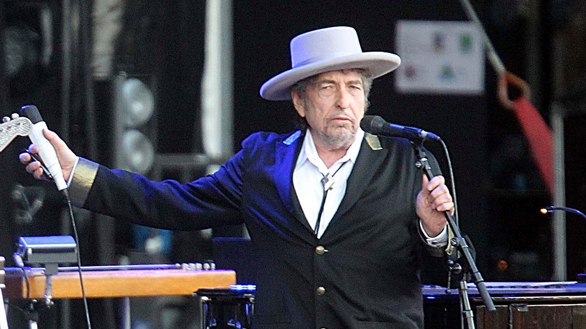 "This July 22, 2012, file photo shows U.S. singer-songwriter Bob Dylan performing onstage at ""Les Vieilles Charrues"" Festival in Carhaix, western France."