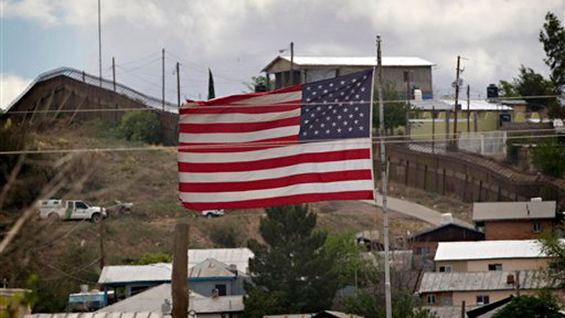 In this April 22 photo, the American flag flies along the international border in Nogales, Ariz. (AP Photo)