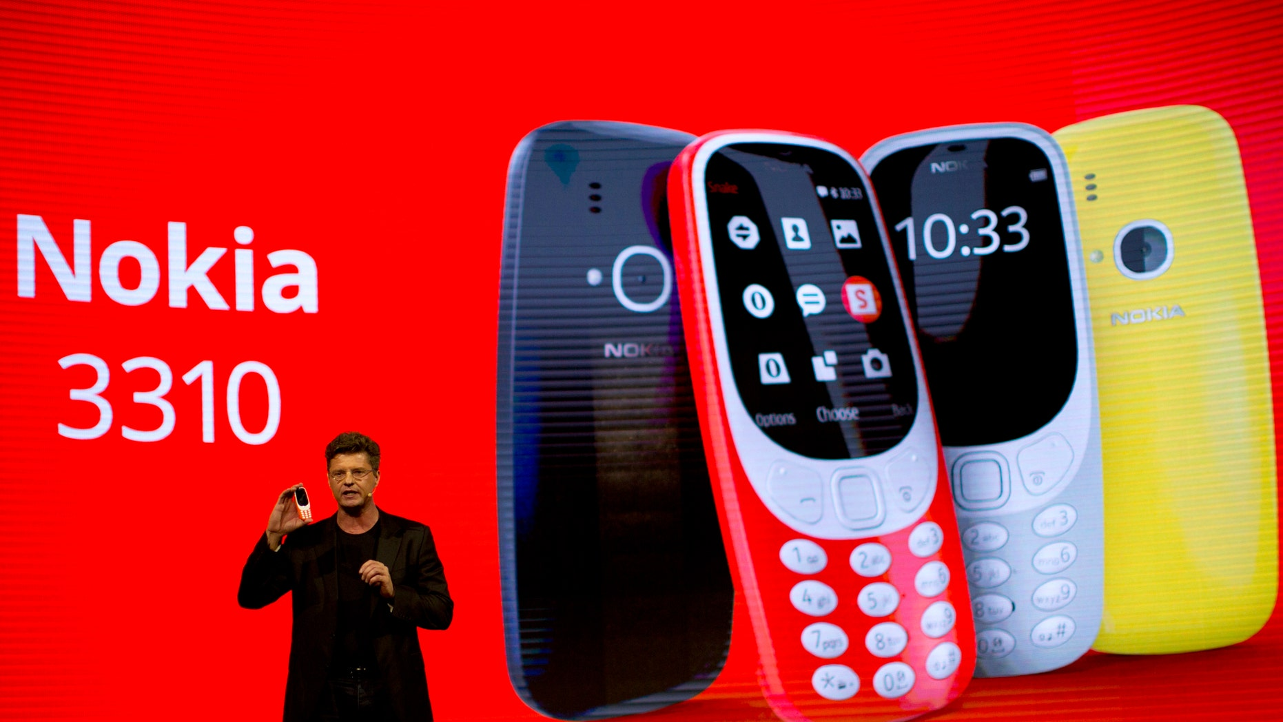 Arto Nummela, Chief Executive Officer at HMD Global, shows the new re-launched Nokia 3310 phone, ahead of Monday's opening of the Mobile World Congress wireless show in Barcelona, Spain, Sunday, Feb. 26, 2017. (AP Photo/Emilio Morenatti)
