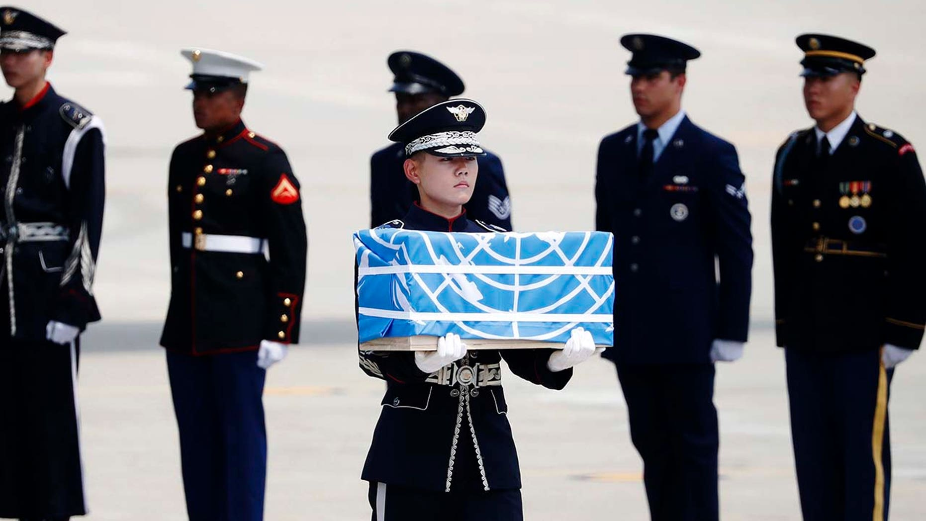 A soldier carries a casket containing what was believed to be the remains of a U.S. soldier who was killed in the Korean War, during a ceremony at Osan Air Base in Pyeongtaek, South Korea, July 27, 2018.