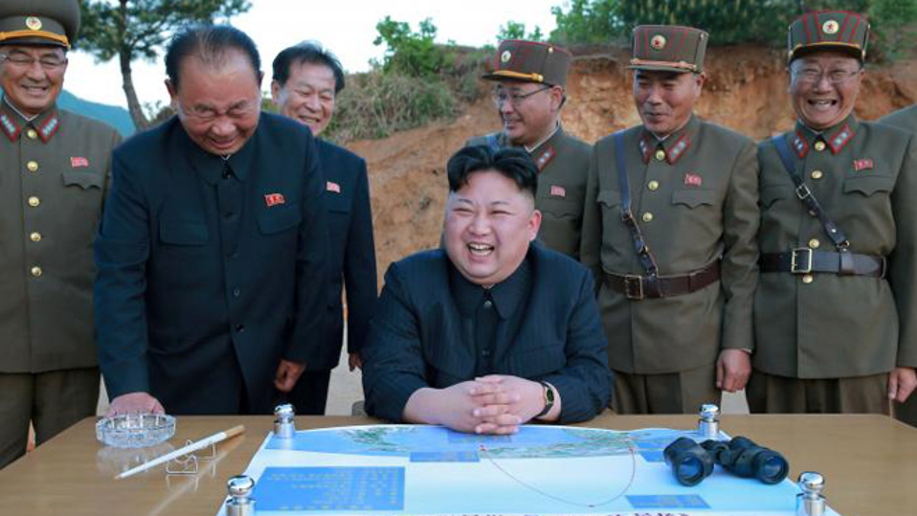 : North Korean leader Kim Jong Un reacts during the long-range strategic ballistic rocket test launch with Ri Pyong Chol (2nd L), Kim Jong Sik (C) and Jang Chang Ha (2nd R).