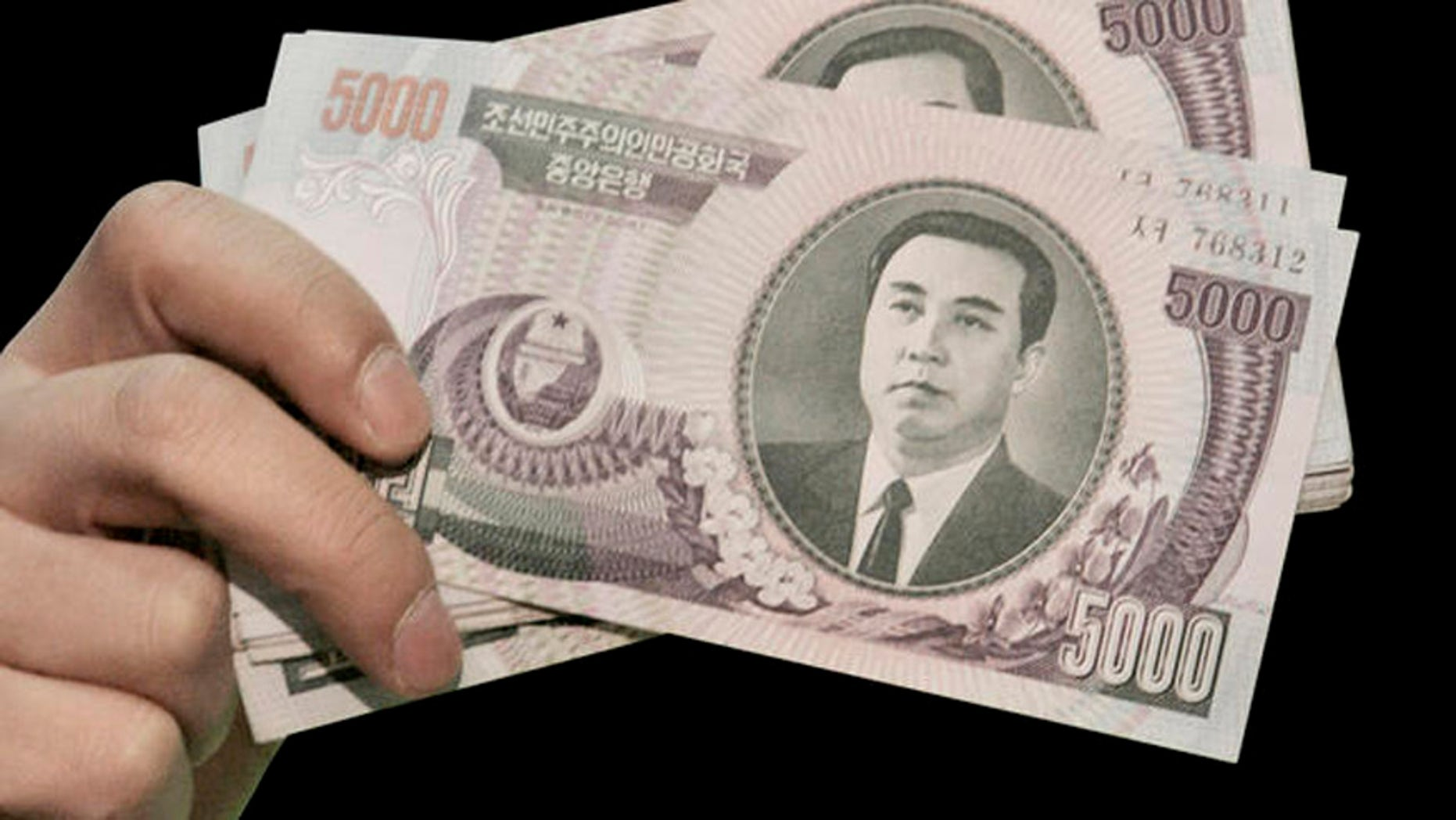 North Korean 5,000 won bank notes.
