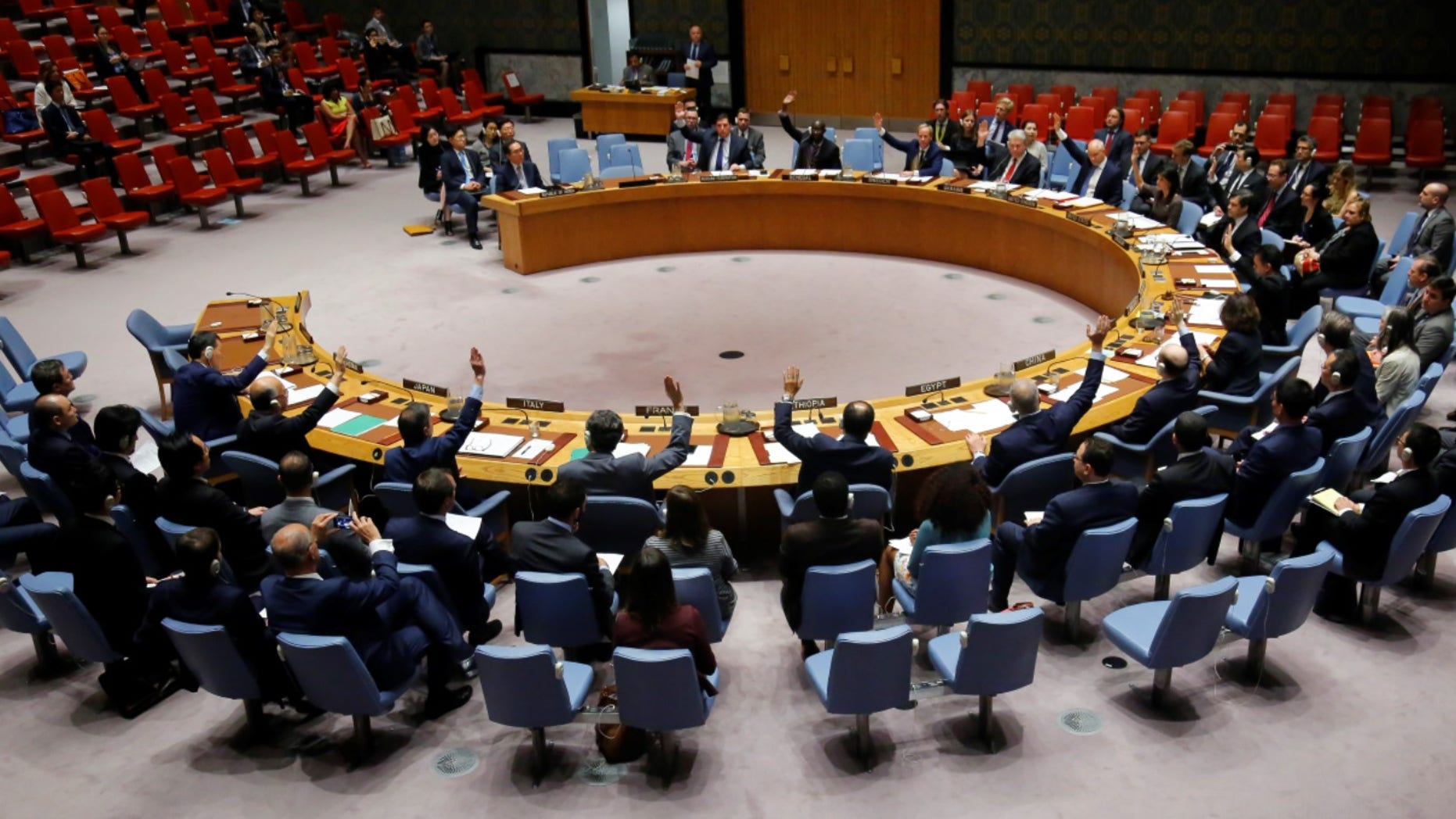 Ambassadors to the United Nations raise hands in a U.N. Security Council resolution vote to sanction North Korea, Friday, June 2, 2017, at U.N. headquarters. (AP Photo/Bebeto Matthews)