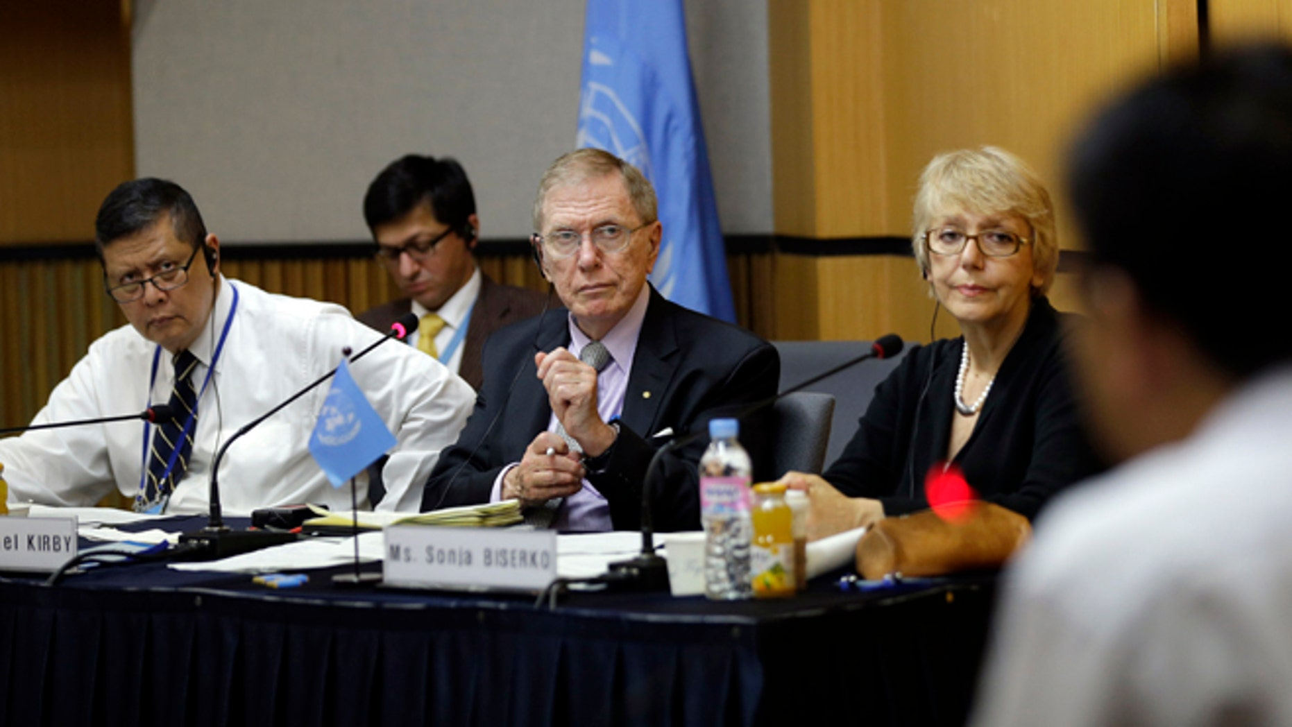Aug. 21, 2013: In this photo, Michael Donald Kirby, center, the chairman of the U.N. commission of Inquiry on human rights in North Korea, listens to Ahn Myung-chul, right, who worked as a guard and driver at several political prisoner camps in the 1990s before defecting to south, during the U.N. hearing in Seoul, South Korea.