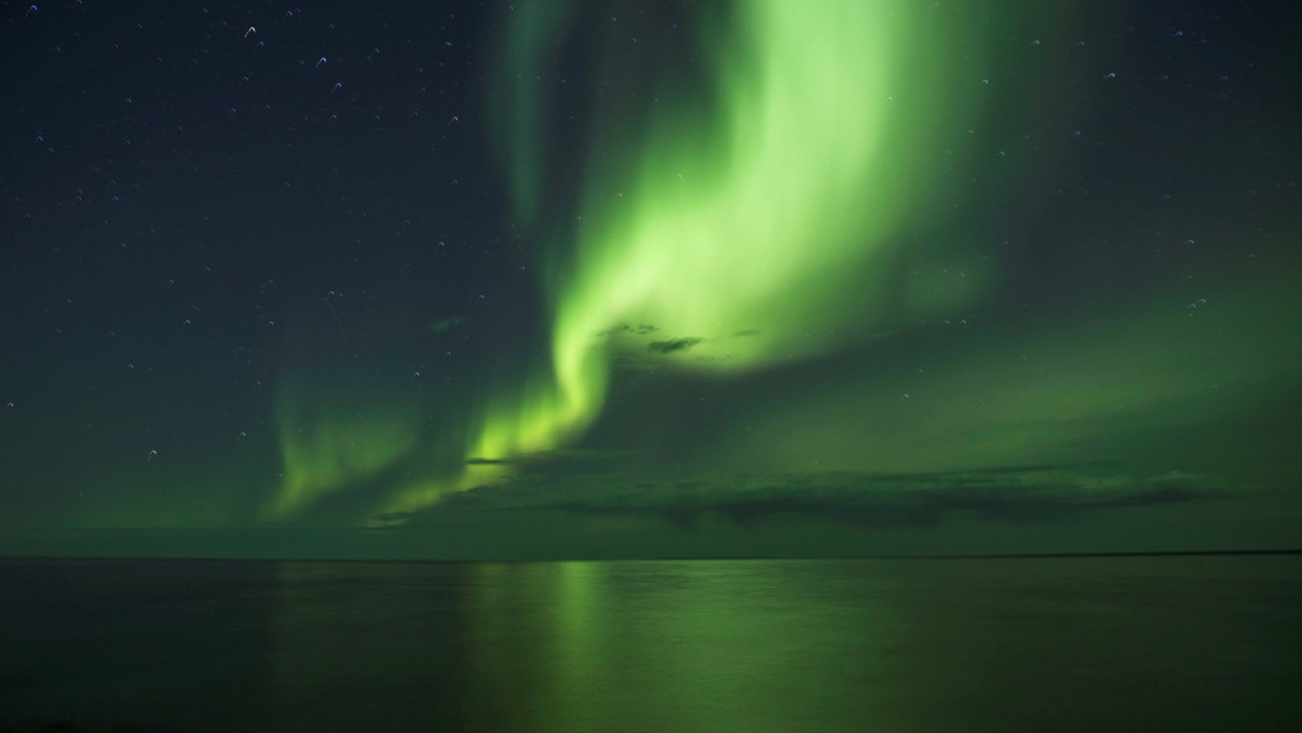 "Northern lights are caused by ""collisions between fast-moving particles (electrons) from space"" an Earth's atmosphere."