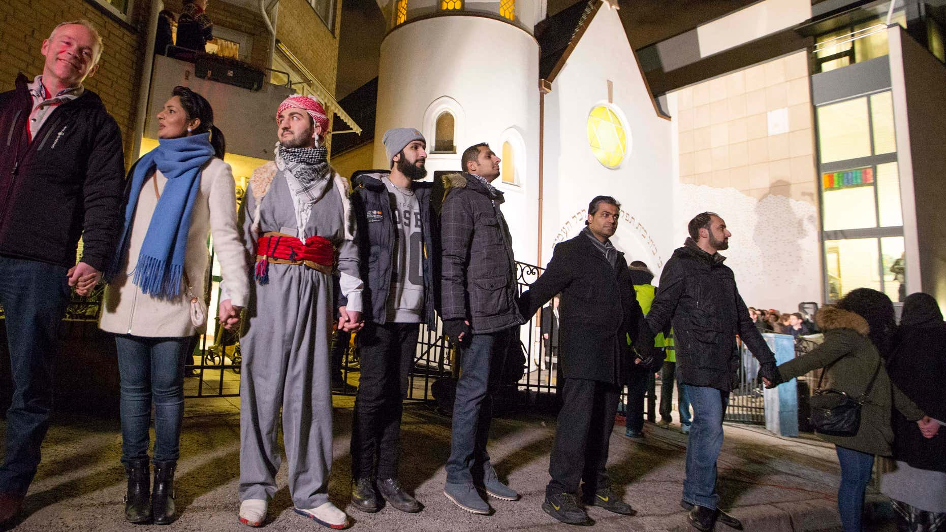 """Feb. 21, 2015: More than 1,000 people formed a """"ring of peace"""" around the Norwegian capital's synagogue, an initiative taken by young Muslims in Norway after a series of attacks against Jews in Europe, in Oslo."""
