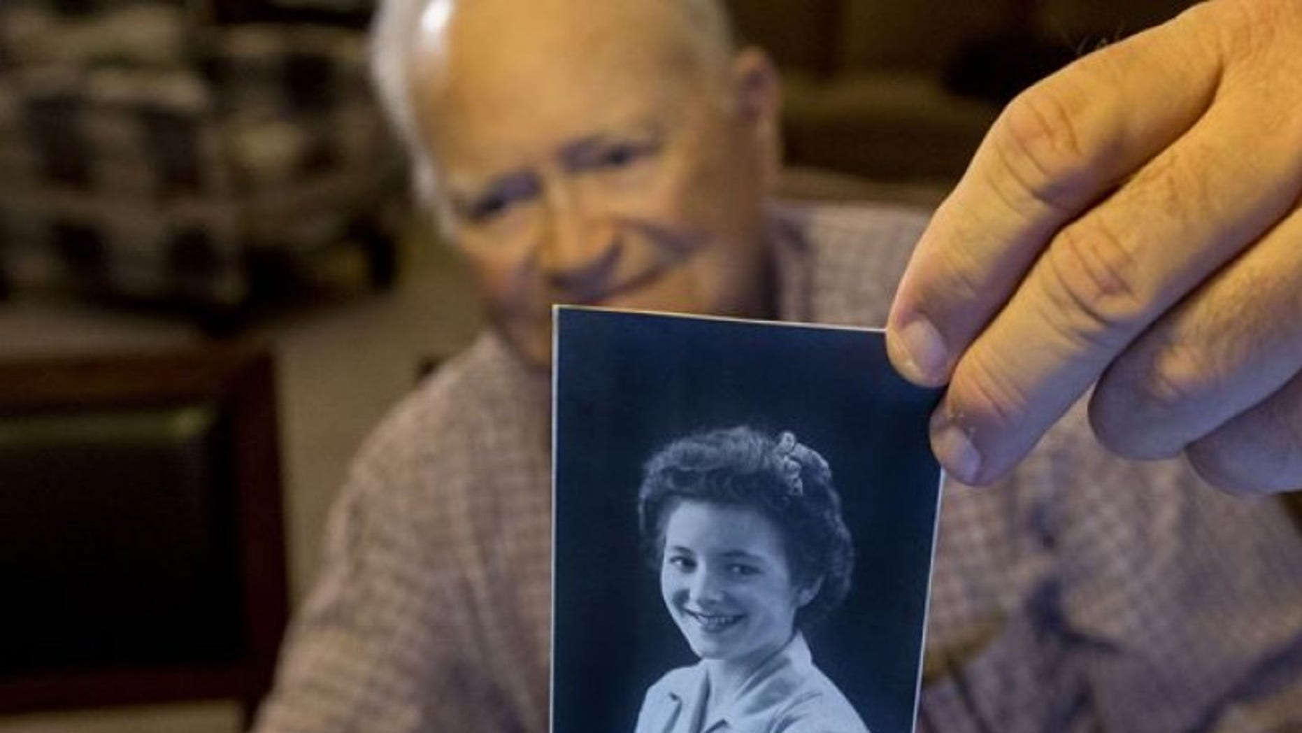 Norwood Thomas with a photo of Joyce Morris.