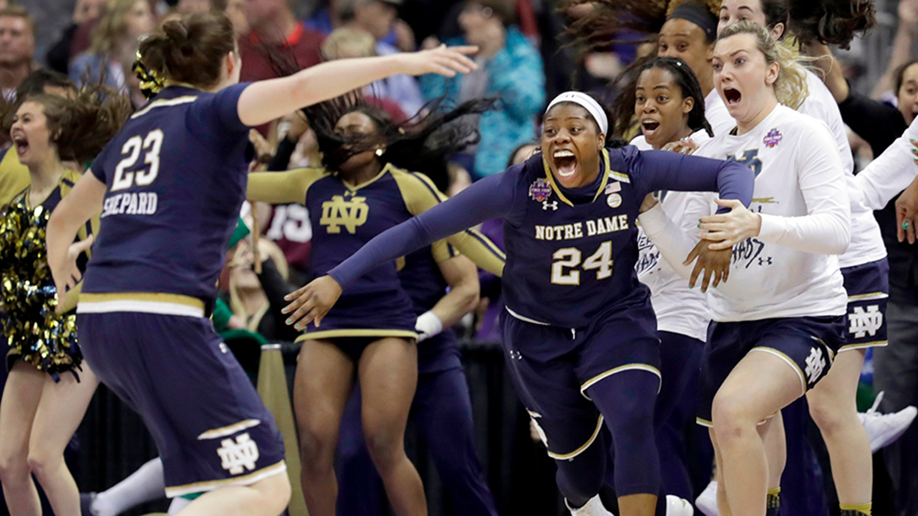 Notre Dame's Arike Ogunbowale (24) clinched the NCAA women's basketball tournament for the Fighting Irish.