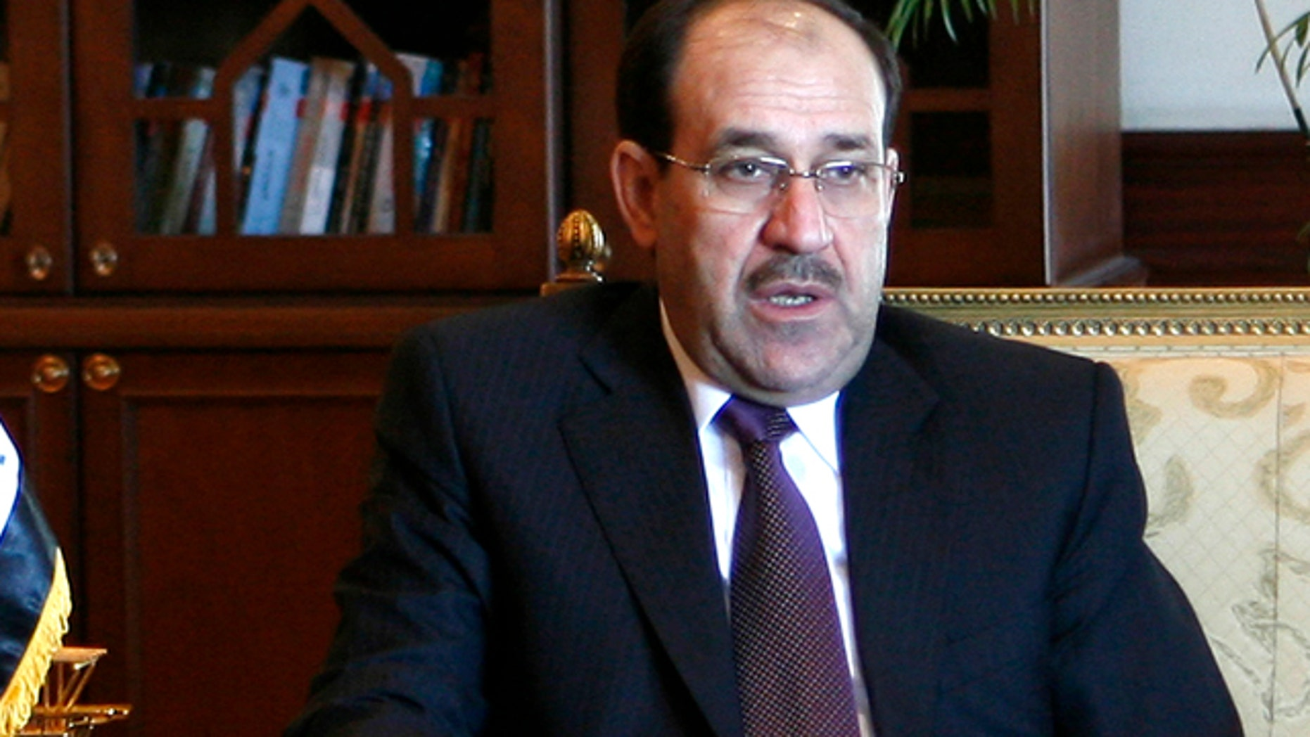 FILE 2009: Iraq's Prime Minister Nouri Maliki gestures during talks with his Egyptian counterpart Ahmed Nazif in Cairo.