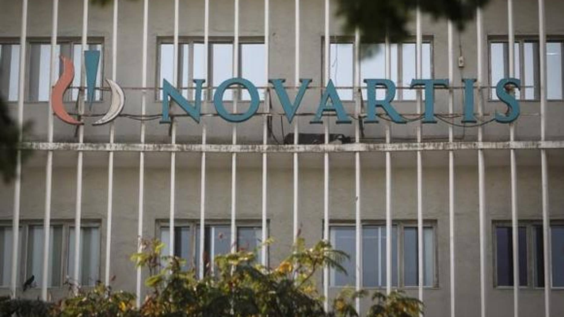 Feb. 6, 2014: A Novartis logo is pictured on its headquarters building in Mumbai.