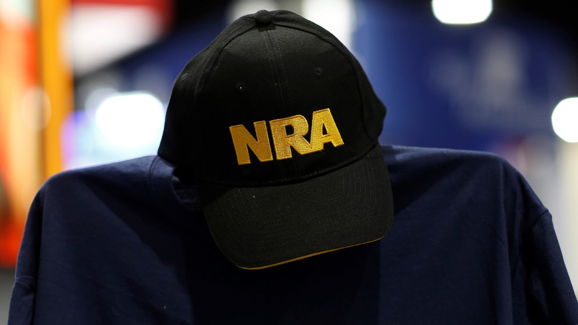 FILE -- A cap and shirt are displayed at the booth for the National Rifle Association (NRA) at the Conservative Political Action Conference (CPAC) at National Harbor, Maryland, U.S., February 23, 2018.