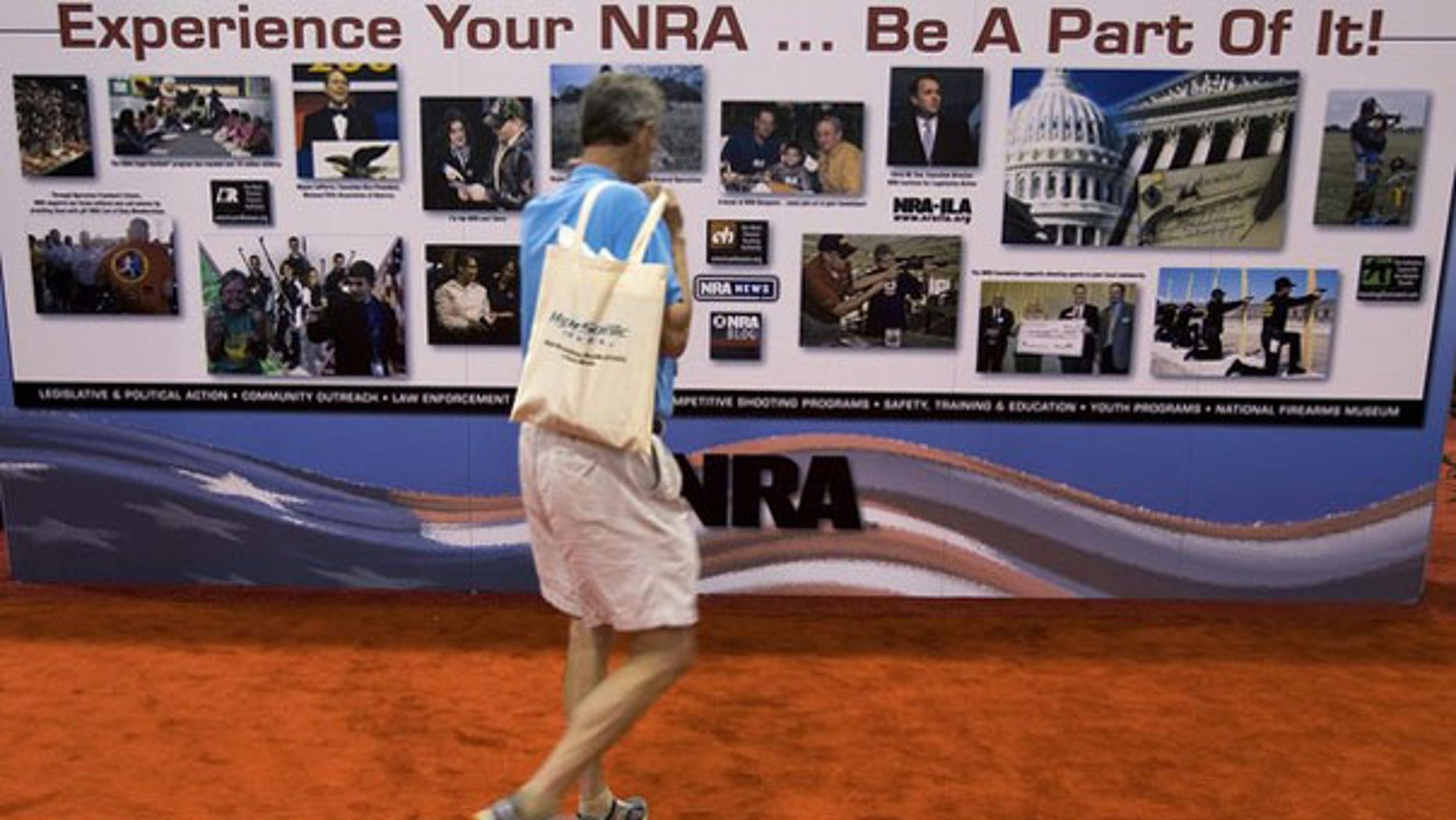 May 15: A man walks past a NRA banner during the National Rifle Association's 139th annual meeting in Charlotte, N.C. (Reuters)