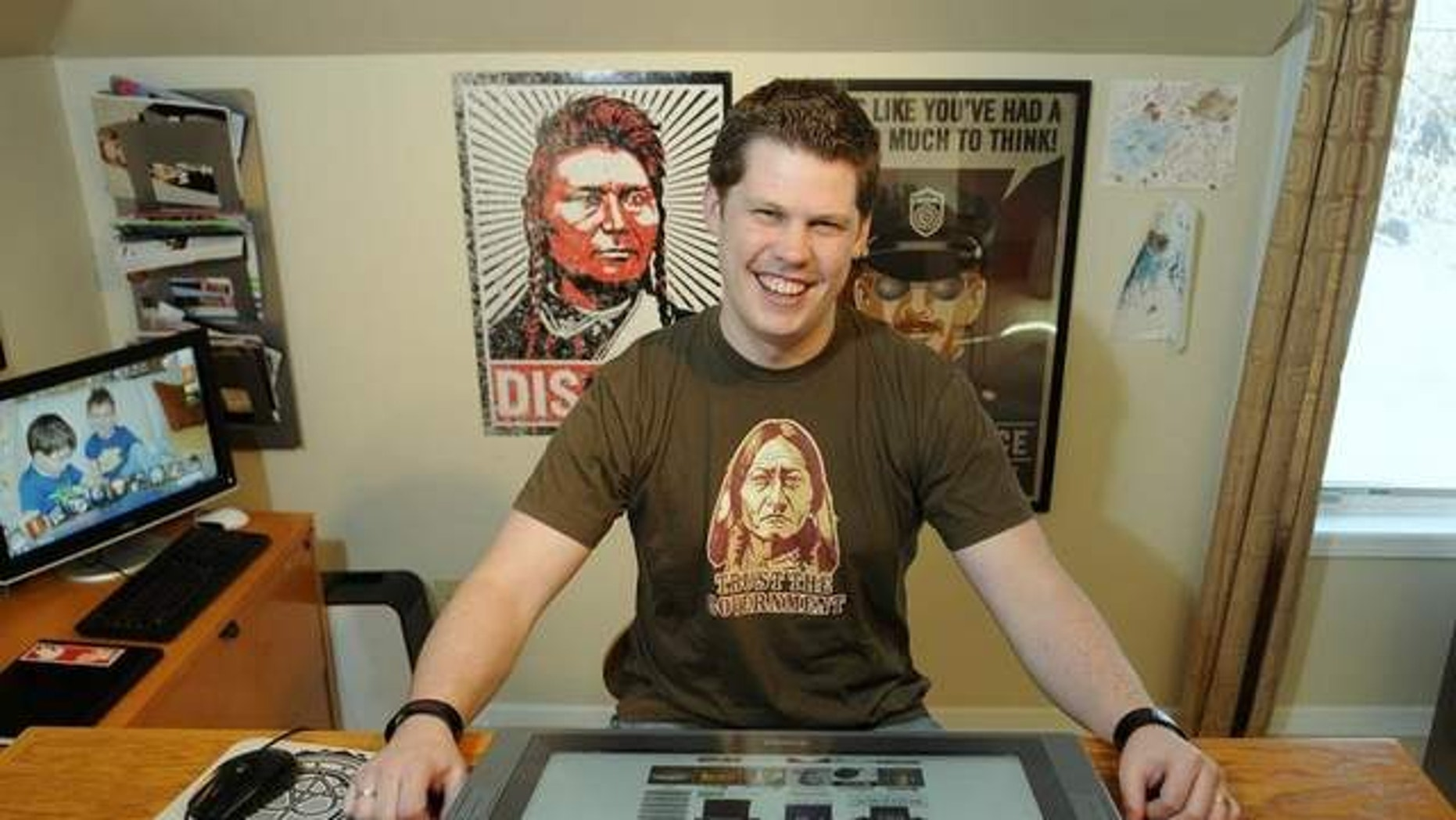 FILE: Nov. 29, 2011: Dan McCall is photogrpahed in his home in Sauk Rapids, Minn. Federal authorities have dropped an attempt to stop a Minnesota man from marketing merchandise poking fun at the National Security Agency for its surveillance of citizens.