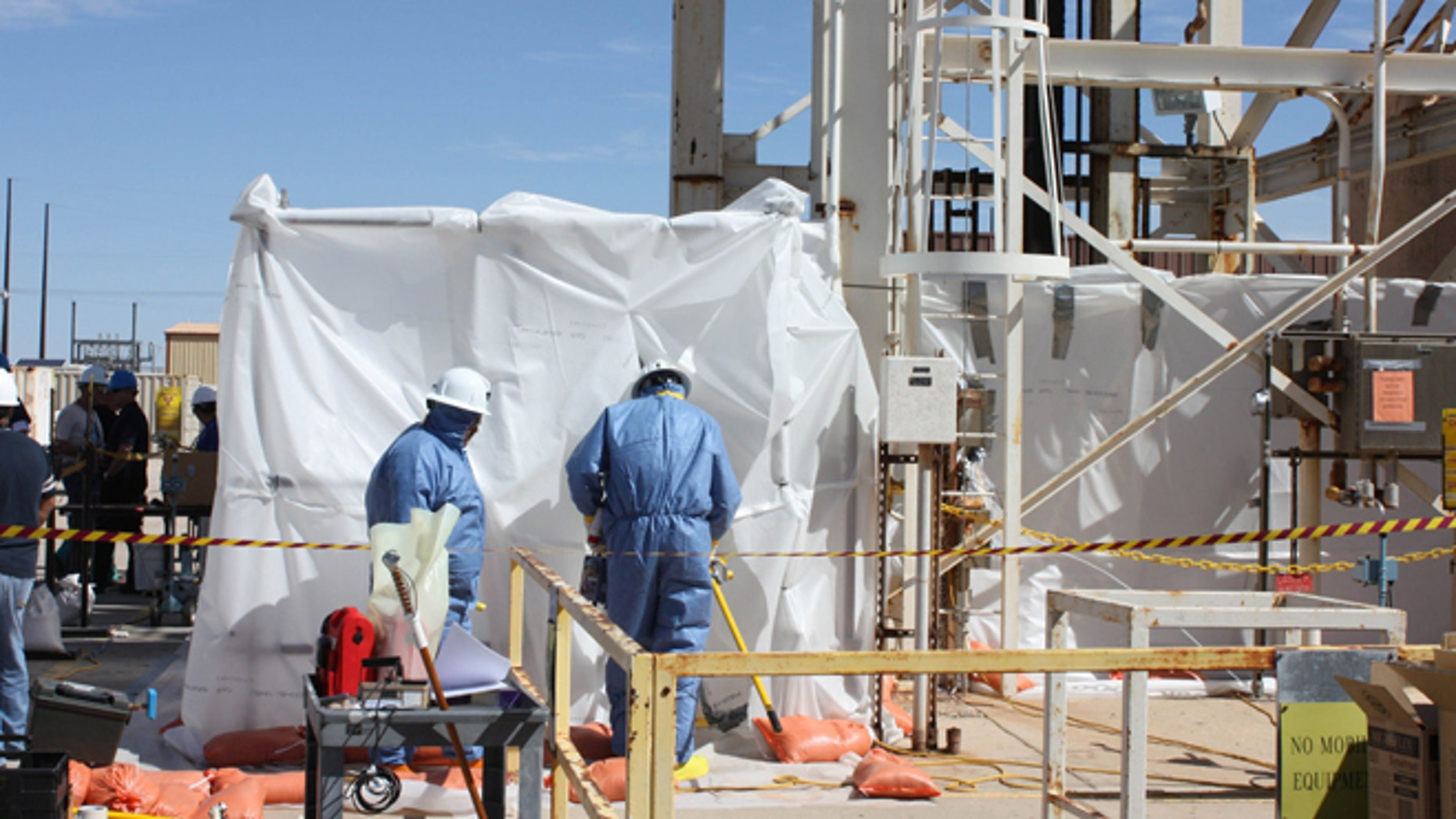 March 7, 2014: In this photo released the U.S. Department of Energy, specially-trained workers make unmanned tests inside a nuclear waste dump in Carlsbad, N.M.