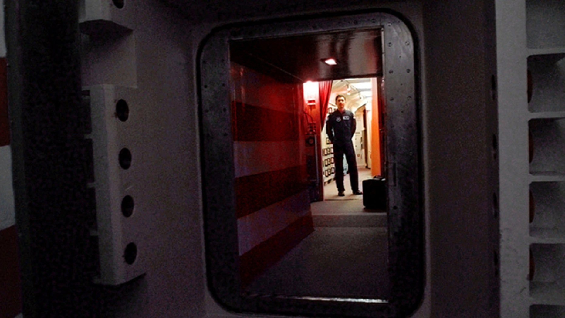 FILE: An Air Force missile crew commander standing at the door of his launch capsule 100-feet under ground where he and his partner are responsible for 10 nuclear-armed ICBM's, in north-central Colorado.