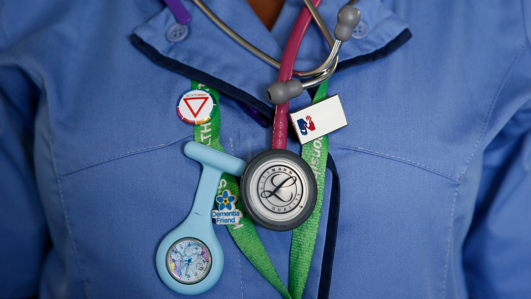 File photo - A nurse wears a watch and stethoscope at St Thomas' Hospital in central London January 28, 2015. (REUTERS/Stefan Wermuth)