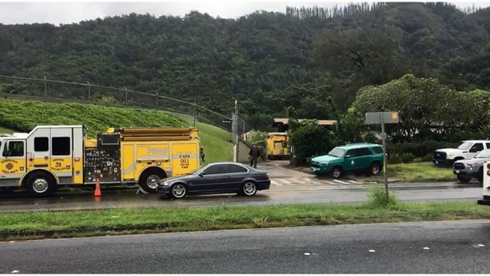 Emergency crews gather near the Nuuanu Reservoir in Oahu, Hawaii.