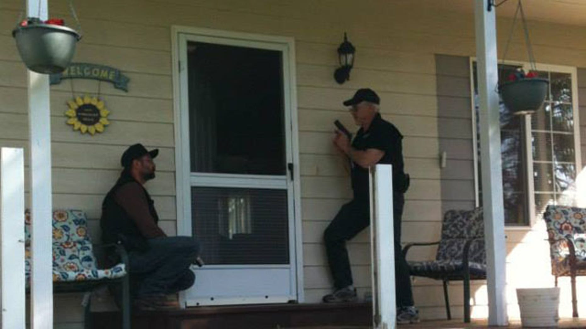 North Valley Community watch members prepare to check on a home.