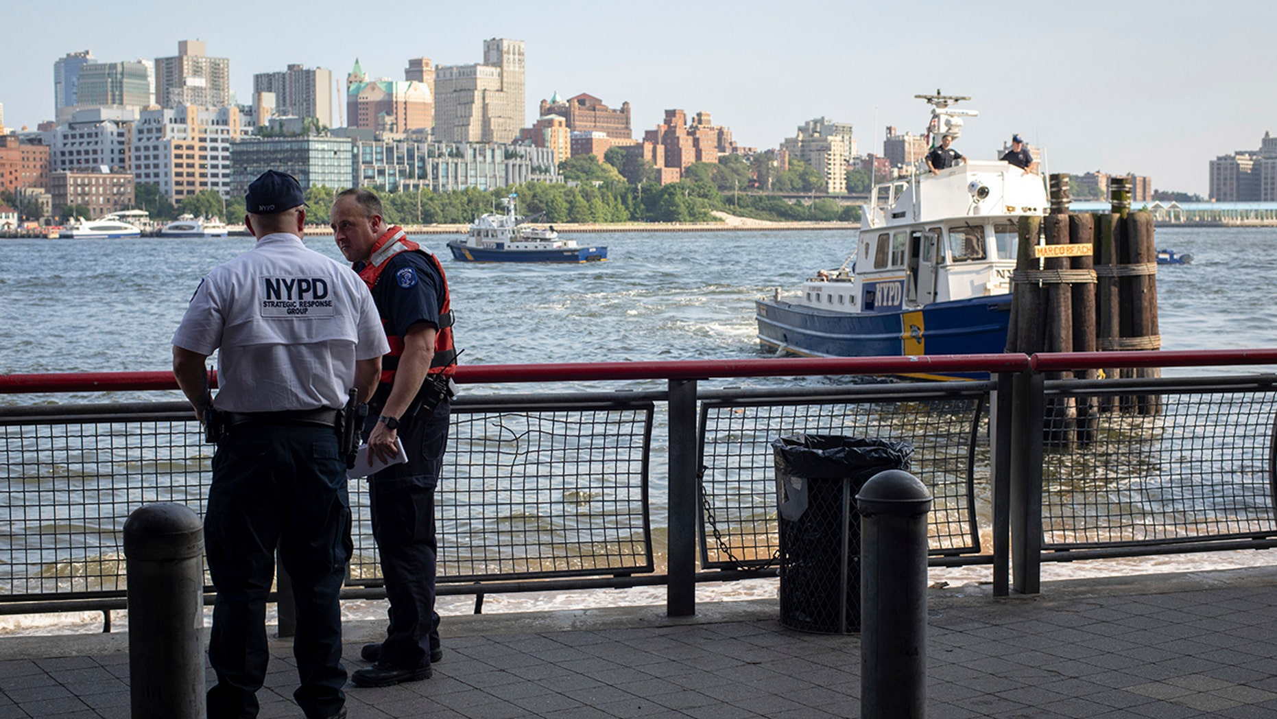 Authorities investigate the death of a baby boy who was found floating in the water near the Brooklyn Bridge in Manhattan.