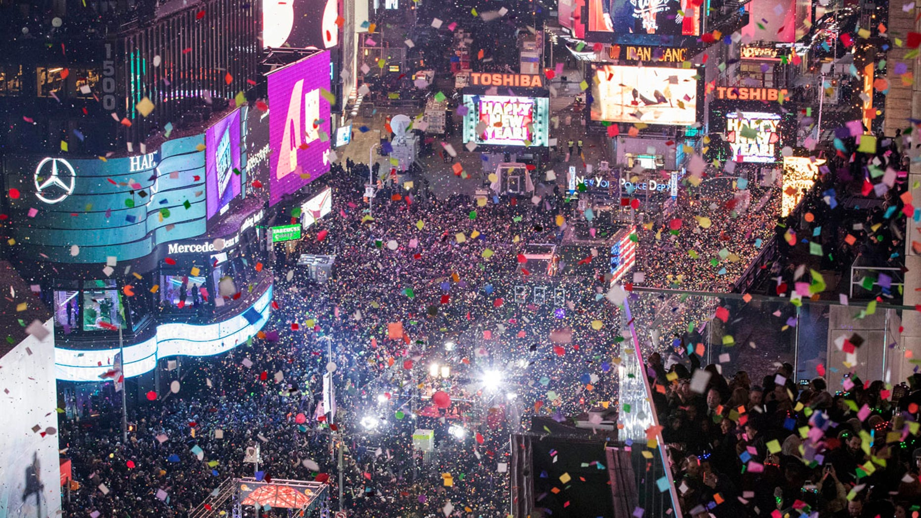 FILE -- Revelers celebrate the new year as confetti flies over New York's Times Square as seen from the Marriott Marquis, Sunday, Jan. 1, 2017.