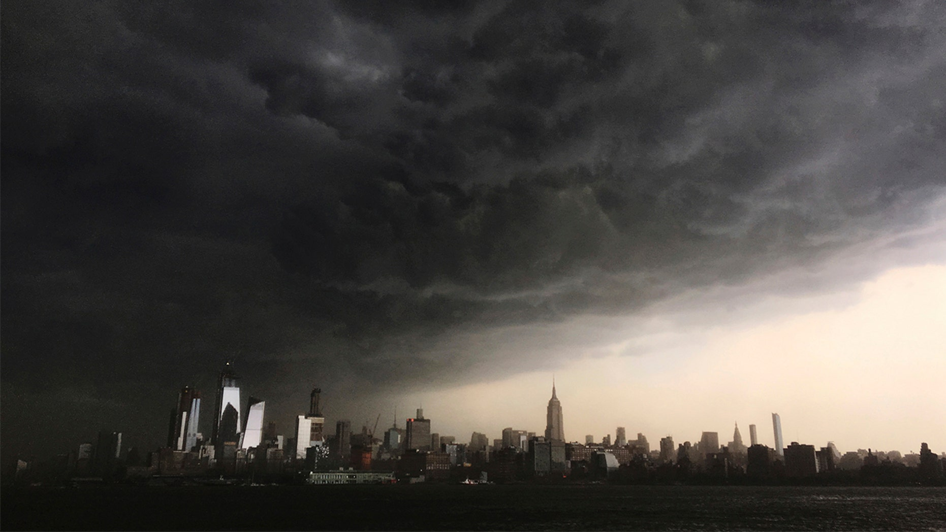 Storm clouds seen gathering over New York City on Tuesday. The National Weather Service on Wednesday said three tornadoes hit parts of New York amid storms across the Northeast on Tuesday.