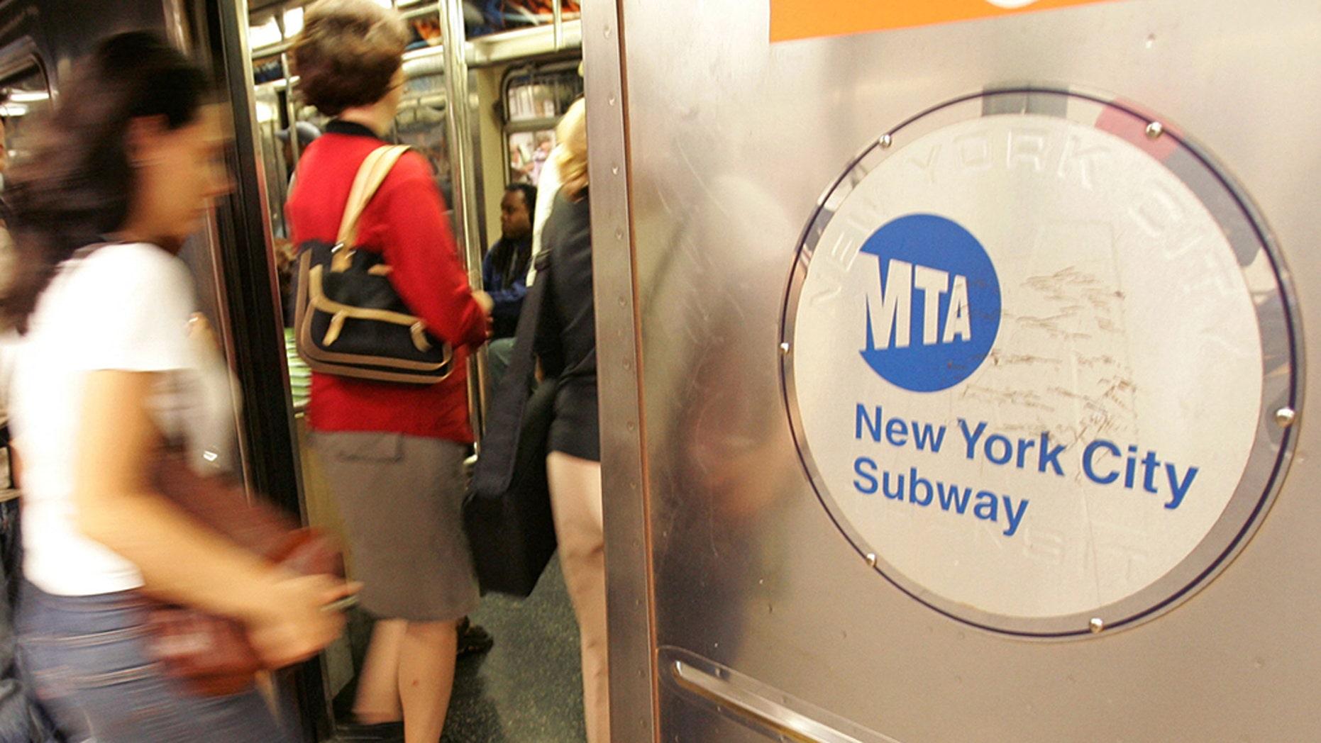 Riders board a subway train in New York City.