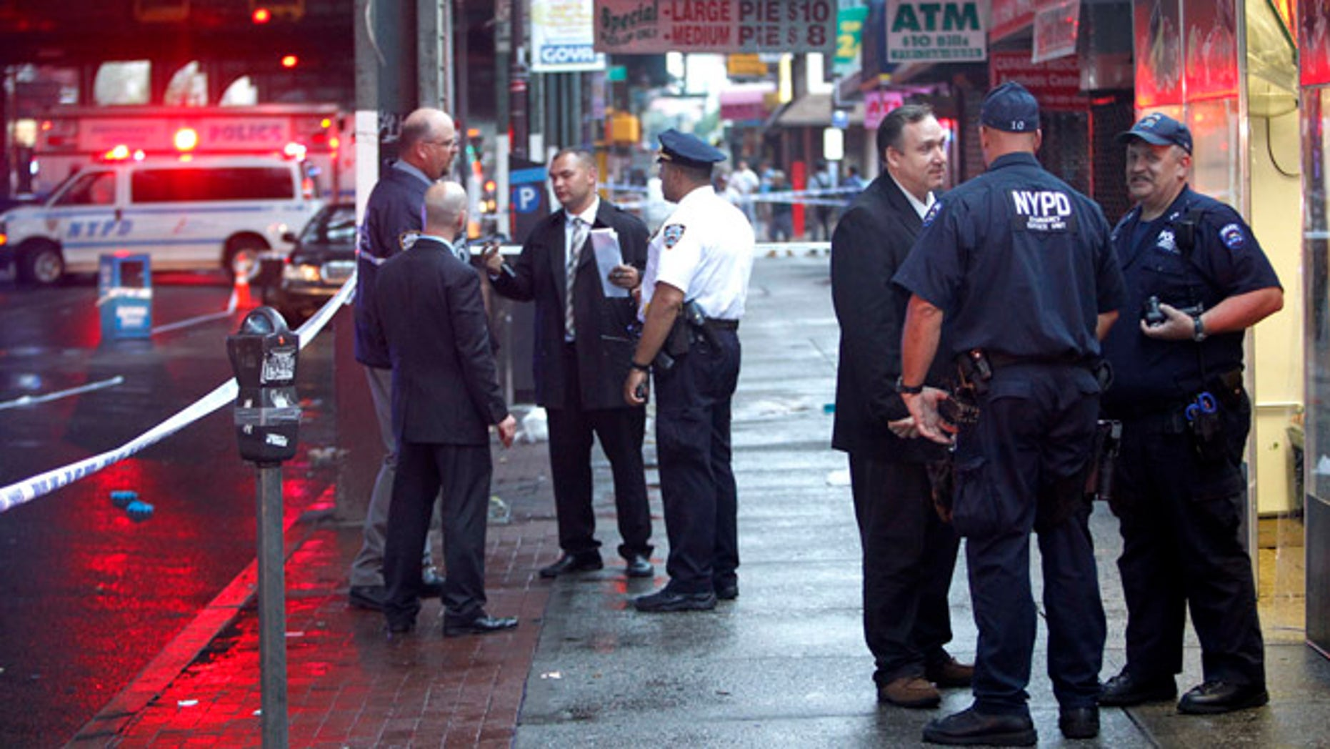 New York police officers inspect a scene in Queens where two people were attacked by a cab driver, witnesses and police say.