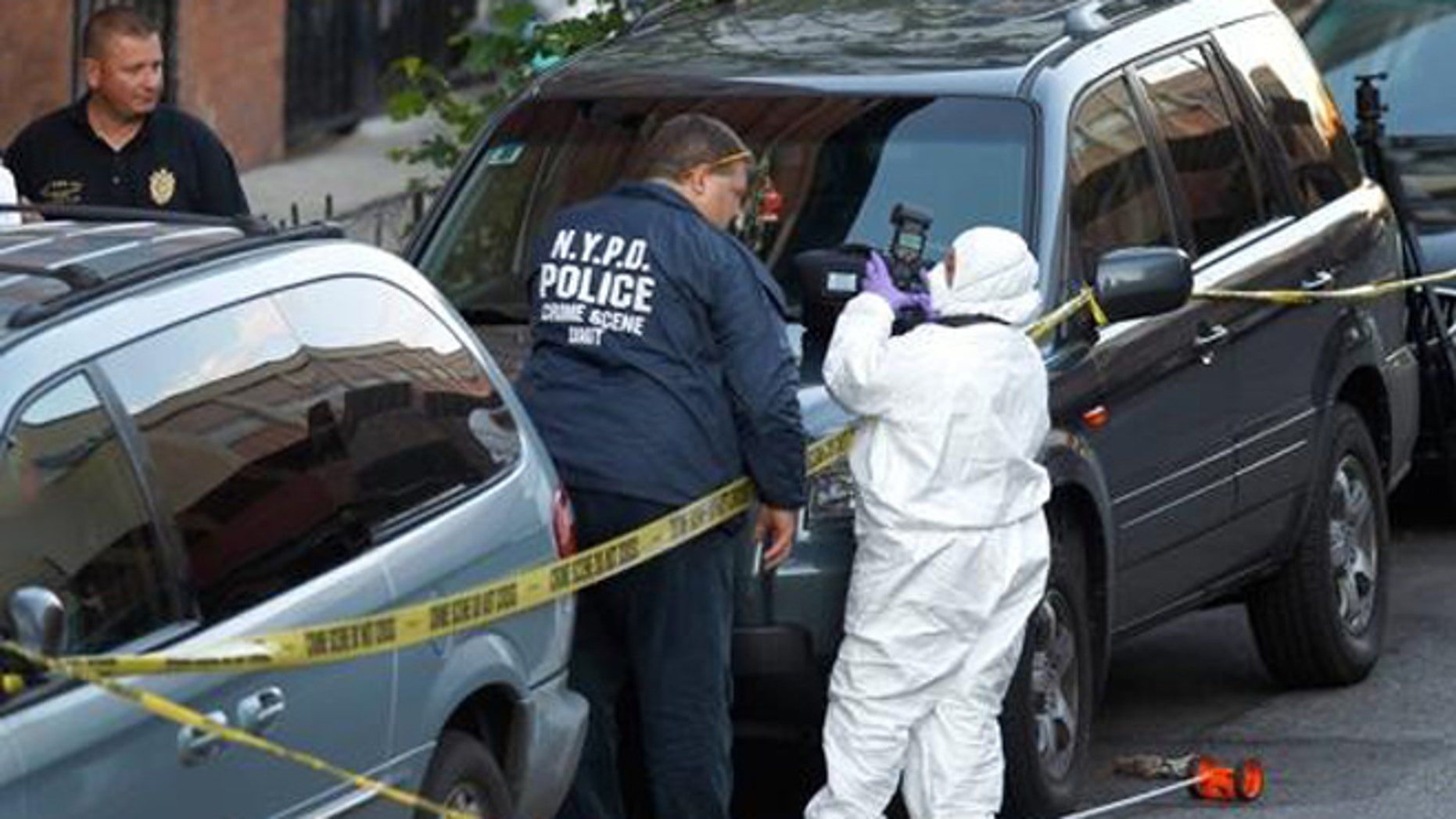 Police investigate the scene of the shooting.