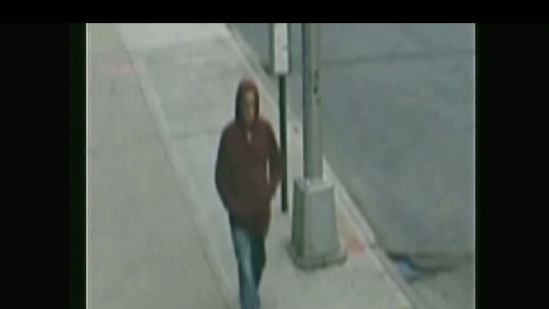 Image of suspect who stole SUV in New York City as a mother loaded groceries into the car that her 2-year-old son was in.