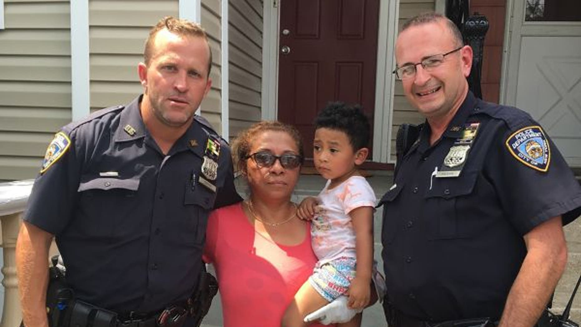 Brian Coffey, left, and John Maderik saved the woman and her 2-year-old grandson from a fire in their New York City home.
