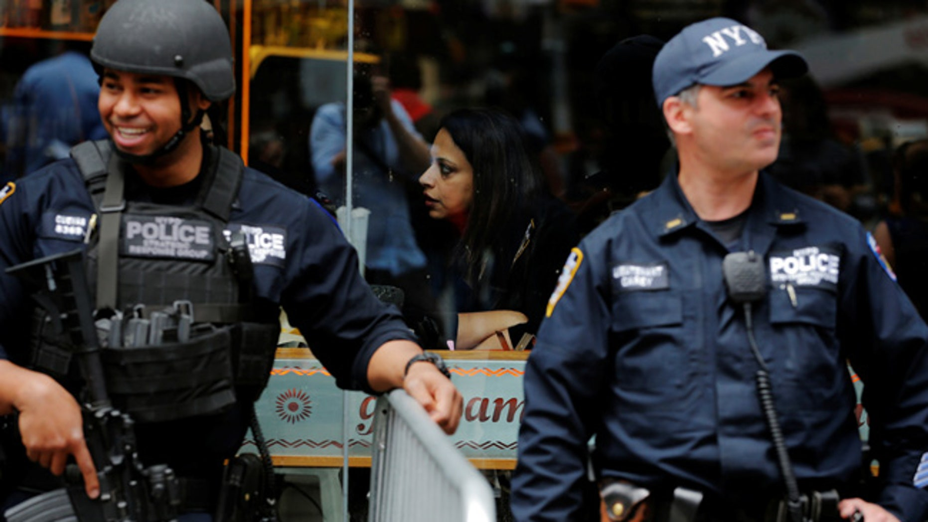 New York Police Department officers monitor crowds in Times Square as part of an increased security presence in New York, U.S., May 23, 2017.  REUTERS/Lucas Jackson - RTX379E0