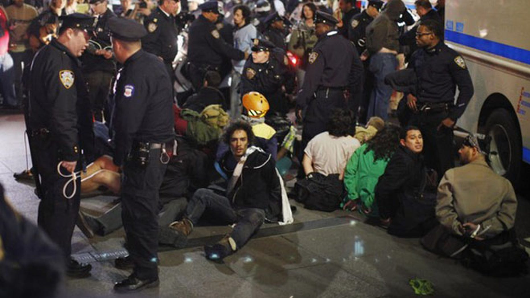 March 17, 2012: Members of the Occupy Wall Street movement are arrested by NYPD officers after protesting at Zuccotti park in New York.